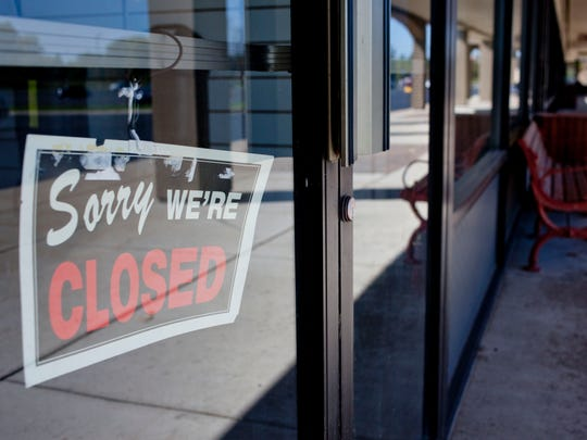 A closed sign hangs in a window Wednesday at the Port Huron Factory Shops in Kimball Township.