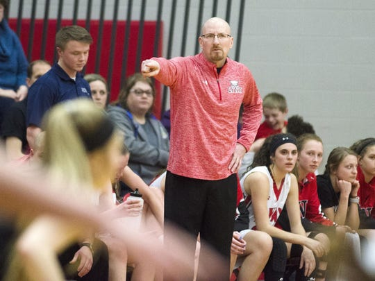 Brandon Valley girls' basketball coach Mark Stadem instructs his team from the sideline Friday, March 2, in the Class AA Round of 16 matchup against Mitchell at Brandon Valley High School.