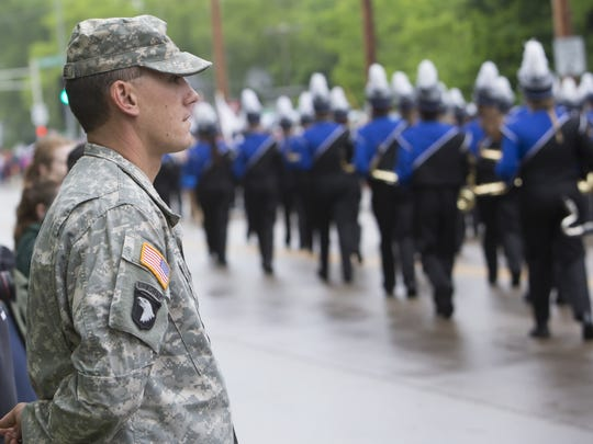 Clarence Meisels stands along Algoma Boulevard as the Memorial Day procession makes its way to Riverside Cemetery in 2015 photo.