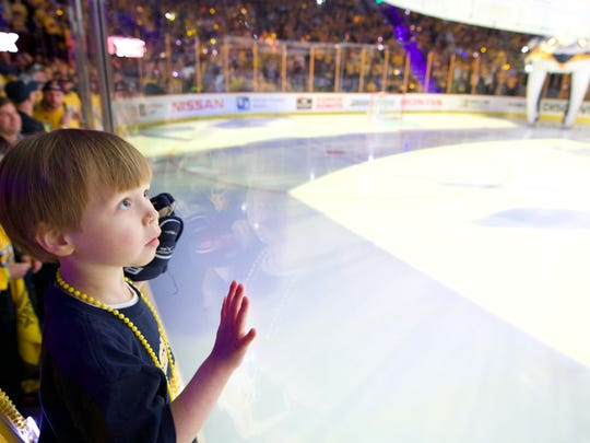 Caleb Daniel watches as the players are introduced before Game 5 of the second round NHL Stanley Cup Playoffs at Bridgestone Arena, Saturday, May 5, 2018, in Nashville, Tenn.