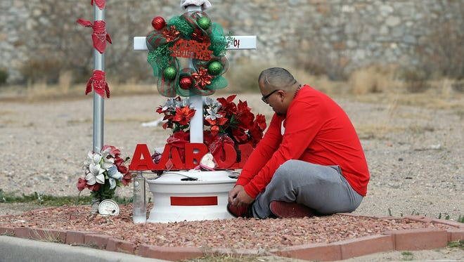 """Ben Ortega used part of his Christmas Day to visit a roadside memorial to his brother-in-law, Aaron Velasquez, along the 1200 block of Lee Treviño in East El Paso. Ortega said Velasquez, 23, died in a traffic accident there in March. The family erected the memorial near the accident scene. Ortega said Velasquez liked to work on cars. """"He impacted a lot of people,"""" he added."""