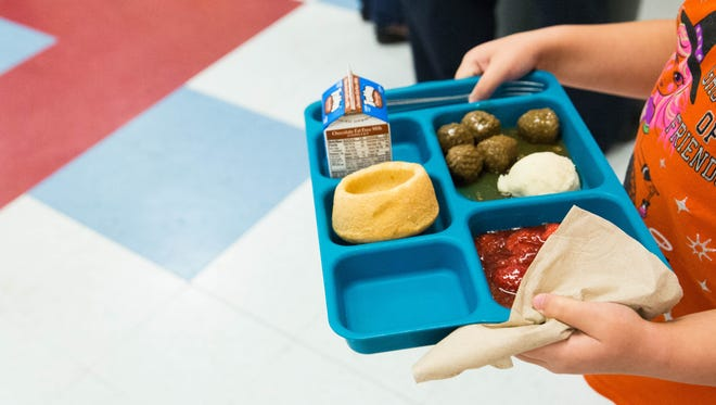 A student walks back to her seat in the lunch room at Alameda Elementary February 28, 2017. Las Cruces Public Schools announced they would be launching a new mobile application and webpage that gives parents a view of the lunch menus and nutritional information of the lunches.