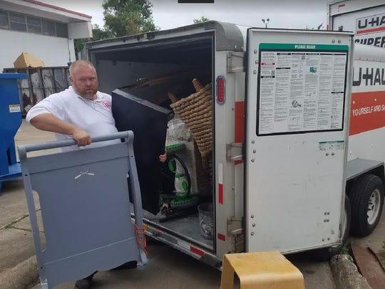 Lt. Mike Evans unloading one of several trucks of donated