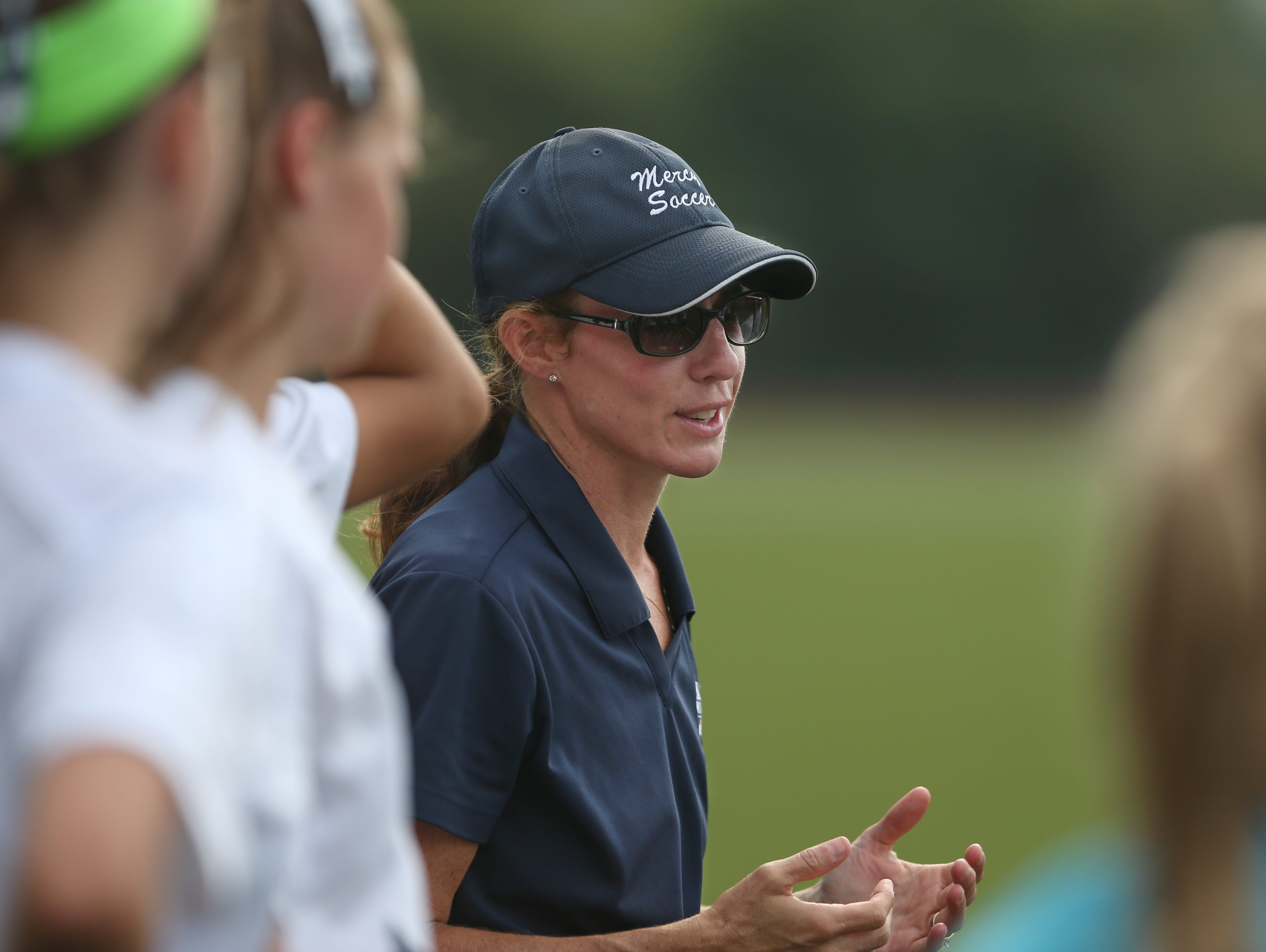 Donna Trost, head coach of Mercy varsity girls soccer, talks to her players before their matchup against Aquinas at Mercy High Tuesday, Sept. 8, 2015 in Brighton.