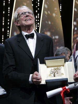 """Director Ken Loach reacts after receiving the Palme d'or for the film """"I, Daniel Blake,"""" during the awards ceremony at the 69th international film festival, Cannes, southern France, Sunday, May 22, 2016. (AP Photo/Thibault Camus)"""