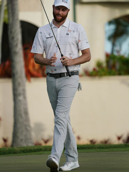 Chris Kirk reacts to his putt on the 16th green during the third round of the Sony Open golf tournament, Saturday Jan. 13, 2018, in Honolulu. (AP Photo/Marco Garcia)