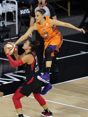 Las Vegas Aces guard Kayla McBride goes up for a shot as Phoenix Mercury guard Diana Taurasi (3) goes airborne in an attempt to block the shot Tuesday, Sept. 1, 2020, in Bradenton, Florida.