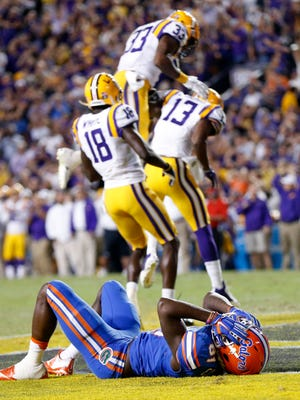 Florida wide receiver Antonio Callaway (81) reacts as LSU celebrates after he dropped a pass in the end zone in the second half of an NCAA college football game in Baton Rouge, La., Saturday, Oct. 17, 2015. LSU won 35-28. (AP Photo/Gerald Herbert)