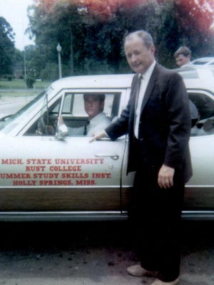 Okemos resident John Duley stands in front of a car headed for Mississippi in the mid-1960s. Duley and others helped historically black Rust College to greater academic achievement.
