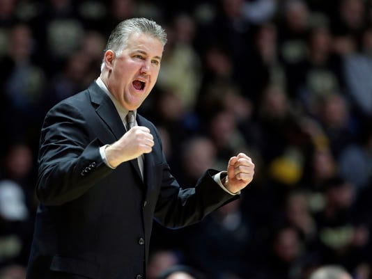 FILE - In this Jan. 16, 2018, file photo, Purdue head coach Matt Painter encourages his team as they play against Wisconsin in the first half of an NCAA college basketball game in West Lafayette, Ind. With the one-and-done parade holding steady, salacious scandals tainting some of the country's powerhouse schools and an ongoing FBI investigation that threatens to overshadow the sport's marquee event, the Boilermakers (28-6) are a refreshing throwback to a simpler time. (AP Photo/Michael Conroy, File)