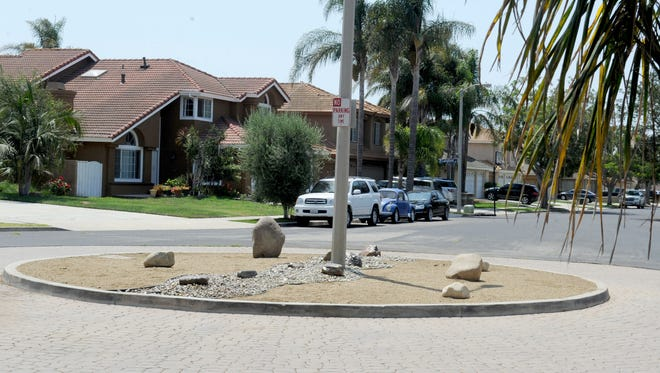 Plants in a traffic circle on Nottingham Drive in Oxnard have been replaced with rocks so neighborhood residents don't have to pay for watering.