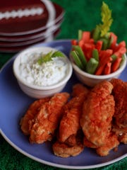 Boneless Buffalo Wings with a spicy blue cheese dip