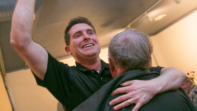 Tony Vero hugs Darrell Banks, after learning he won the race for county commissioner at the Richland County Republican watch party. Vero was victorious against Democrat Gary Utt.