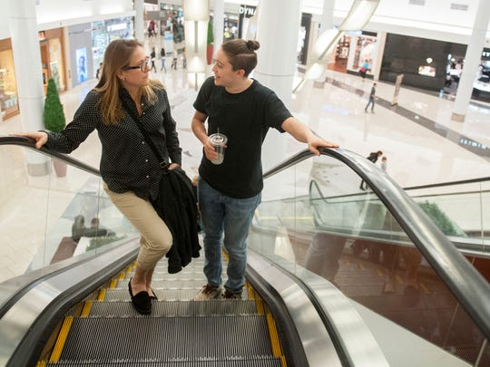 Tammi Grovatt-Dawkins of Marlton, left, and her son Matt, a 17-year old transgender male who is a junior member of the Cherokee High School boys' track team, make their way to Essensuals London Hair Salon in the Cherry Hill Mall so that Matt can attend a haircut appointment.