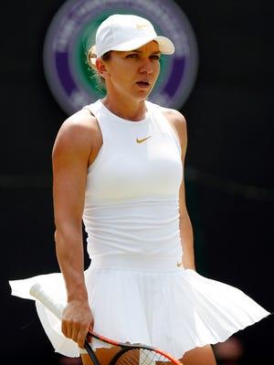 Simona Halep of Romania plays Su-Wei Hsieh of Taiwan in their third-round match during Wimbledon.