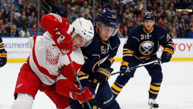 Red Wings left wing Justin Abdelkader (8) and Sabres defenseman Rasmus Ristolainen (55) fight for position during the first period Wednesday in Buffalo, N.Y.