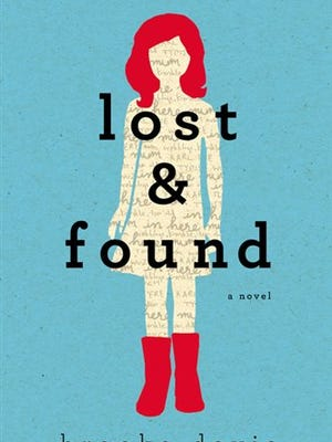 """This book cover image released by Dutton shows """"Lost & Found,"""" by Brooke Davis. (AP Photo/Dutton)"""