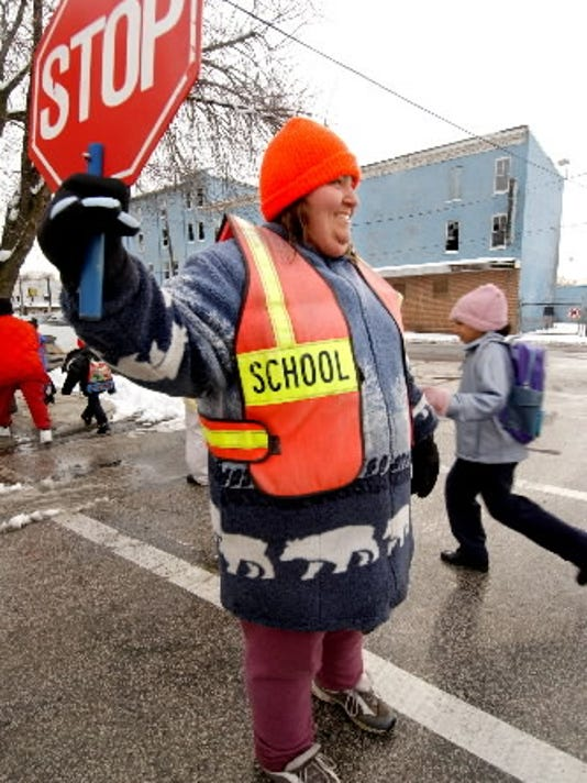 Tina Decker, crossing guard, helps students make their way to Goode Elementary in York in this 2005 photo.