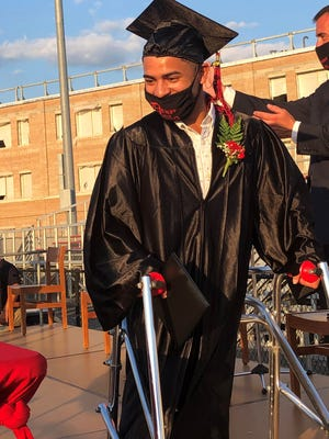 A mask can only partially conceal the big smile of Allens Maldonado after he received his diploma from Principal Matthew Desmarais during Durfee High School's graduation on Tuesday at Mac Aldrich Field.