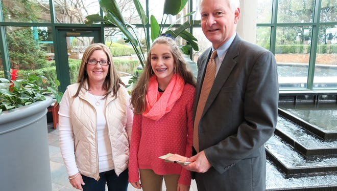 For the third consecutive year, Ginger Dailey, at center with mom Tammy and the Spartanburg Regional Foundation's John Dargan, has diverted a potential birthday windfall to help Gibbs Cancer Center patients.