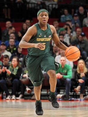 Cassius Winston brings the ball up the court against DePaul at Moda Center in Portland. He had 10 points, eight rebounds and eight assists in the 73-51 win.