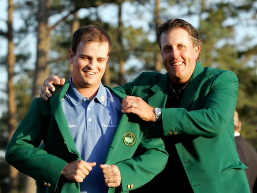 Zach Johnson, left, receives the Masters green jacket from last year's champion Phil Mickelson after winning the 2007 Masters golf tournament at the  Augusta National Golf Club in Augusta, Ga., Sunday, April 8, 2007.