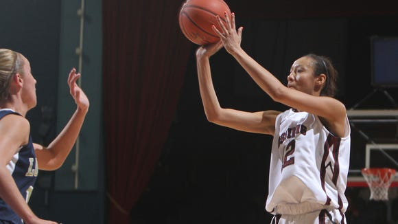 Ossining's Saniya Chong (12) goes up for a against Lourdes during the girls basketball Class AA Section 1 championship at the Westchester County Center in White Plains March 4, 2012.