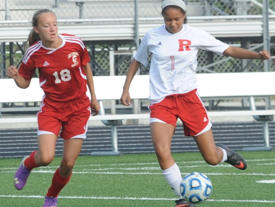 Richmond's Lillian Sagna passes the ball against Connersville's Hollie Hoffman during Thursday's game at Lyboult Field.