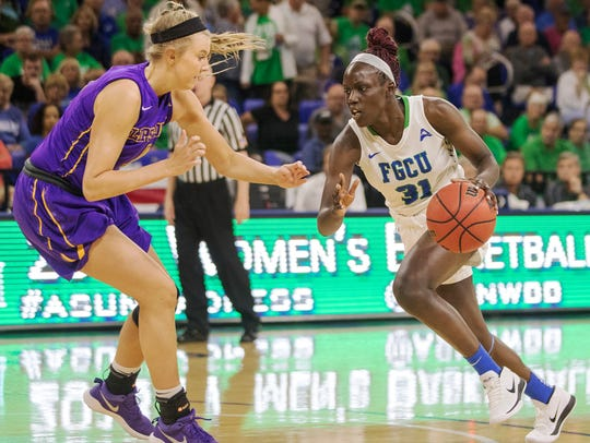 FGCU's Nasrin Ulel drives to the basket against Lipscomb