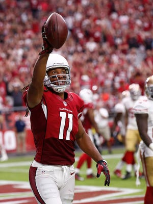 Cardinals receiver Larry Fitzgerald reacts after scoring a touchdown against the 49ers in the second half on Sept. 27, 2015, in Glendale.
