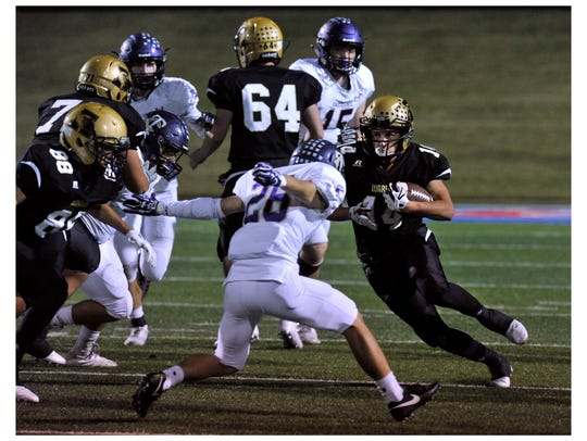 Abilene High School running back Esai Jaques carries the ball against Timber Creek in their 2017 game at Shotwell Stadium. Abilene High won, 40-14.