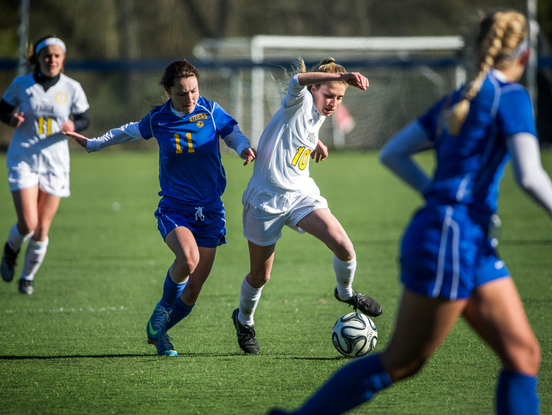 Padua's Ashlee Brentlinger (right) works past Caesar Rodney's Cowan Cummings (left) in the second half of Padua's 2-0 win over Caesar Rodney at the Hockessin Soccer Club on Tuesday afternoon.