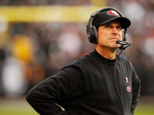 Jim Harbaugh is seen here during a break in the action