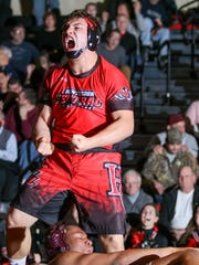 Hunterdon Central's Lukas Bakerian reacts after defeating Phillipsburg's Shamyr Brodders during the 195 pound weight class bout at Hunterdon Central on Jan. 10, 2018.