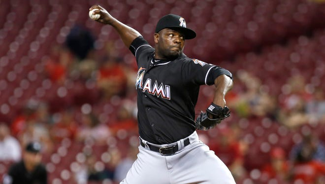 Aug 15, 2016; Cincinnati, OH, USA; Marlins relief pitcher Fernando Rodney throws against the Reds during the ninth inning at Great American Ball Park. The Marlins won 6-3.