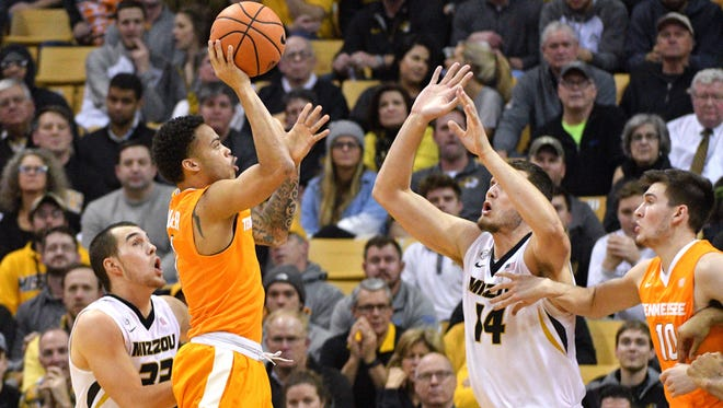 Jan 17, 2018; Columbia, MO, USA; Tennessee Volunteers guard Lamonte Turner (1) shoots a jump shot as Missouri Tigers forward Reed Nikko (14) defends during the first half at Mizzou Arena. Mandatory Credit: Denny Medley-USA TODAY Sports