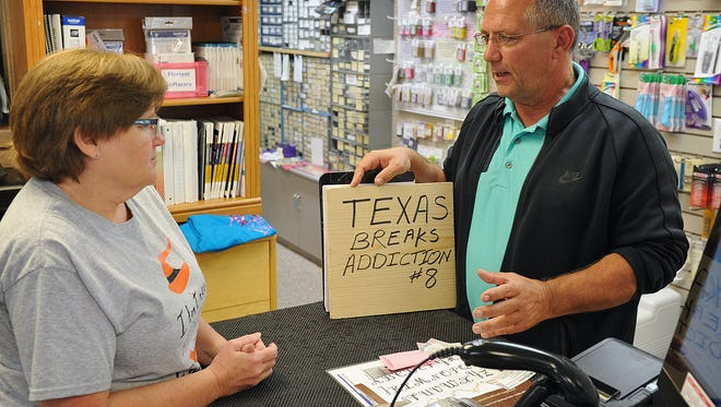 Dan McQueen talks with Carol Baird at Ace Sewing Center Monday morning. McQueen was in Wichita Falls campaigning for the U. S. Senate seat held by Ted Cruz.