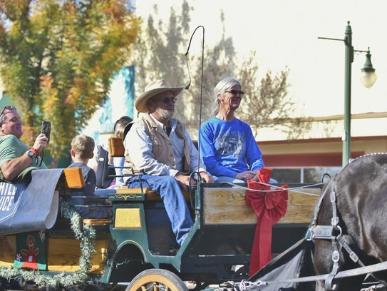 Horse-drawn carriage rides were offered to shoppers