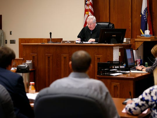 Judge David Jones listens to arguments on a motion