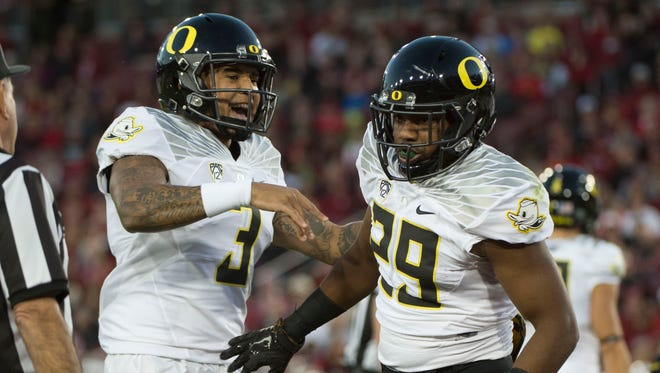 November 14, 2015; Stanford, CA, USA; Oregon Ducks running back Kani Benoit (29) is congratulated by quarterback Vernon Adams Jr. (3) for scoring a touchdown against the Stanford Cardinal during the first quarter at Stanford Stadium. Mandatory Credit: Kyle Terada-USA TODAY Sports