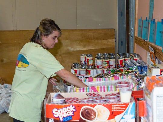 Heidi Rose packs 92 bags of food a week during the