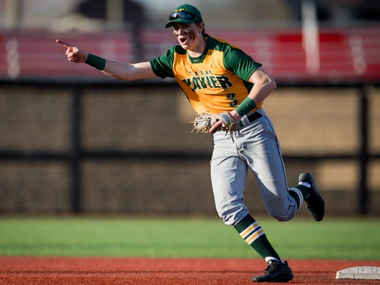 St Xavier's Trey Sweeney celebrates after making a double play during the game played against Trinity at the University of Louisville in Louisville, Ky., Thursday, April 12, 2018.