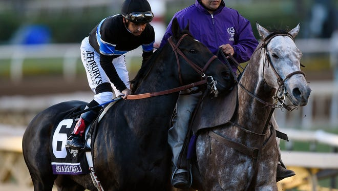 November 1, 2014; Santa Anita , CA, USA; Mike Smith aboard Shared Belief is escorted to the starting gate before race twelve during the 2014 Breeders Cup Championships at Santa Anita Park. Mandatory Credit: Kelvin Kuo-USA TODAY Sports