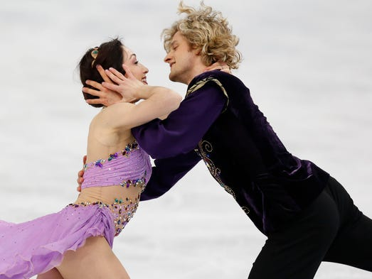 Charlie White and Meryl Davis (USA) perform during the ice dance free dance program. Davis and White won gold.