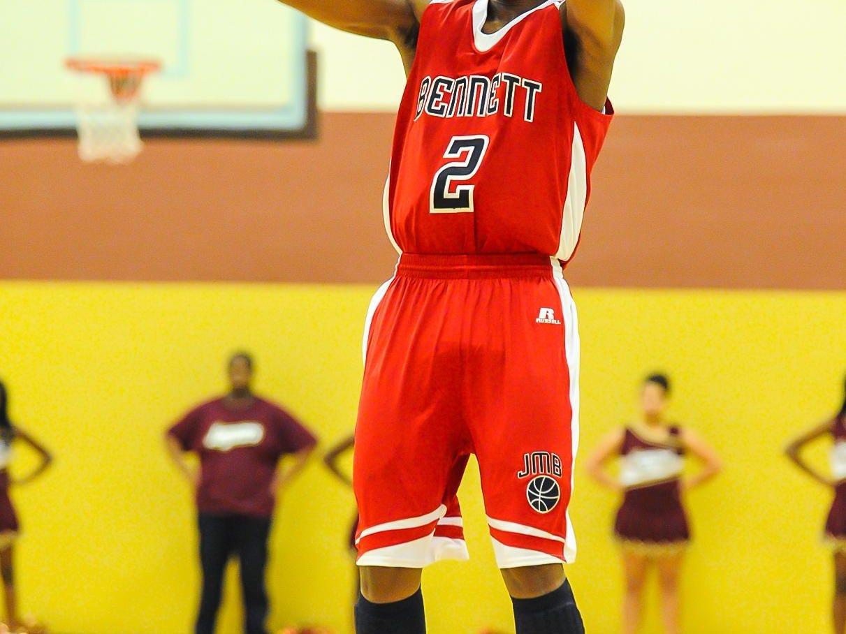 James M Bennett's Jorden Duffy takes a shot against Washington High.
