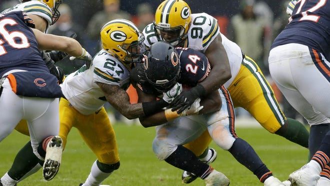 PACKERS13 PACKERS  - Green Bay Packers safety Josh Jones (27) and Green Bay Packers defensive tackle Montravius Adams (90) tackle Chicago Bears running back Jordan Howard (24) during the 2nd quarter of the Green Bay Packers game against the Chicago Bears at Soldier Field in Chicago, Ill. on Sunday, November 12, 2017.  Mike De Sisti / Milwaukee Journal Sentinel