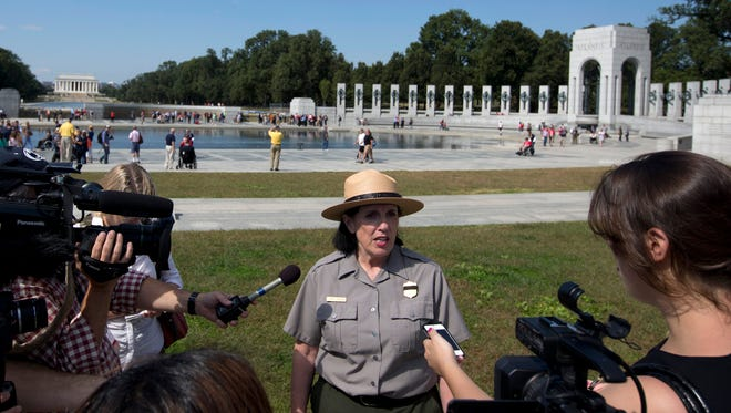 National Park Service spokeswoman Carol Johnson speaks to reporters at the National World War II Memorial in Washington on Tuesday.