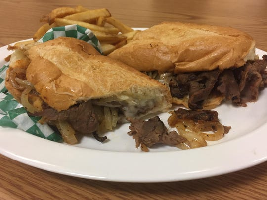 At Bada Bing's in Midtown Reno, a cheesesteak with onions and provolone is better than a version with those fixings plus green peppers, but both sandwiches still need sturdier buns so things don't get soggy.