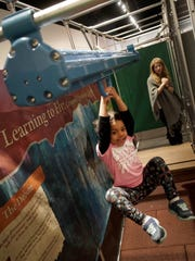 4 year-old Selah Hauser, of Newark, takes ride in one of the interactive learning areas in the Dinosaur Revolution maze at the Delaware Museum of Natural History.