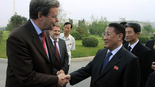 In this Sept. 6, 2014 file photo, North Korea's Kang Sok Ju, right, a member of the Political Bureau of the Central Committee of the Workers' Party of Korea (WPK) and secretary of the WPK, shakes hands with German Ambassador to North Korea Thomas Schaefer as he leaves Pyongyang Airport in Pyongyang, North Korea to visit Germany, Belgium, Switzerland, Italy and Mongolia. Kang, a top North Korean diplomat who negotiated a short-lived 1994 deal with the United States to freeze its nuclear programs in exchange for international aid, has died of cancer, the country's state media said Saturday, May 21, 2016.